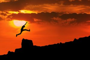 Man who had neurofeedback jumping over obstacle